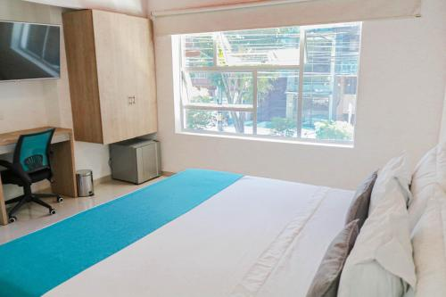 A bed or beds in a room at Hotel Boutique Laureles Medellin (HBL)