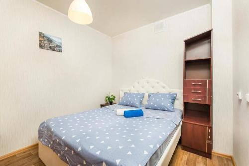 Кровать или кровати в номере Чистопольская 64