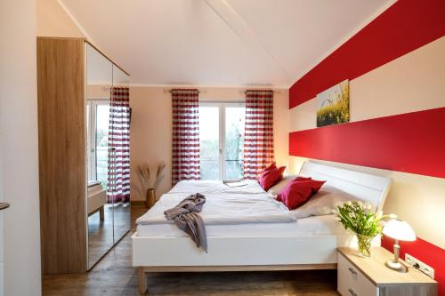 A bed or beds in a room at Bauernhof Lafrenz