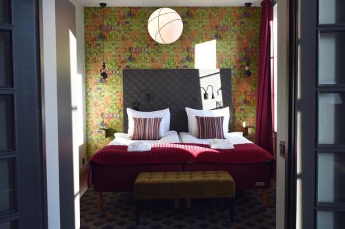 Säng eller sängar i ett rum på Hotel Opera