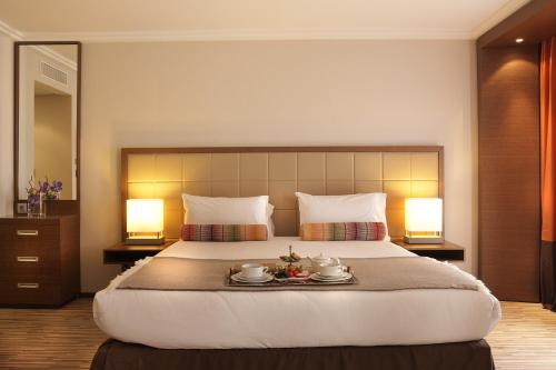 A bed or beds in a room at AC Hotel by Marriott Ambassadeur Antibes - Juan Les Pins