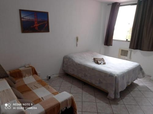 A bed or beds in a room at Apto ProntoCardio Rodoviária