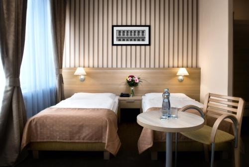 A bed or beds in a room at Hotel Tatra