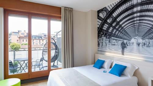 A bed or beds in a room at B&B Hotel Milano Sant'Ambrogio