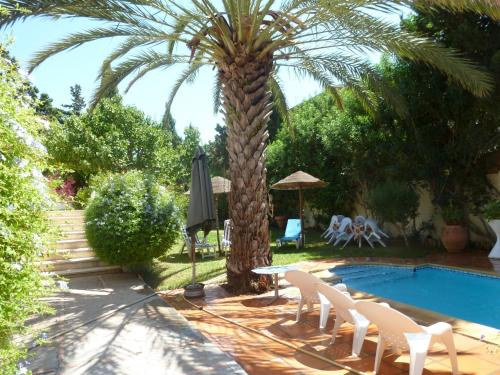 The swimming pool at or near Villa with 4 bedrooms in Hammamet with wonderful sea view private pool enclosed garden 850 m from the beach