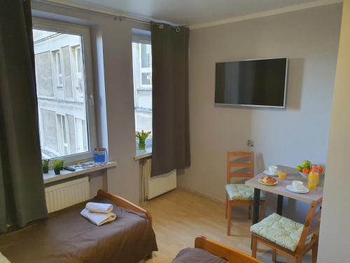 Telewizja i/lub zestaw kina domowego w obiekcie Hostel Camera