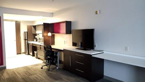 A television and/or entertainment center at Home2 Suites By Hilton Walpole Foxborough