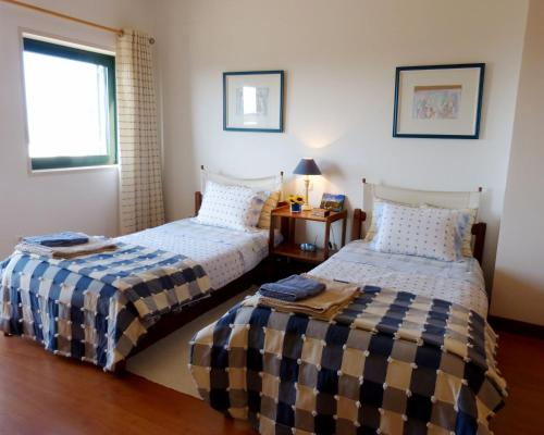 A bed or beds in a room at Monica Lisbon Rentals - Vista Villa
