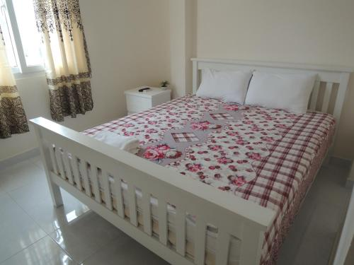 A bed or beds in a room at Saigon Inn