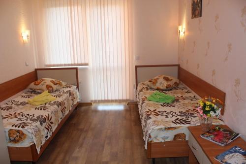 Кровать или кровати в номере Minsk Hotel