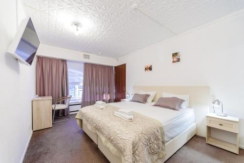 Кровать или кровати в номере Simple Bon Voyage Hotel