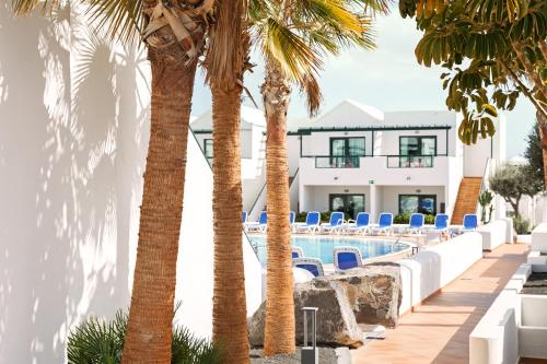 The swimming pool at or near Hotel Pocillos Playa