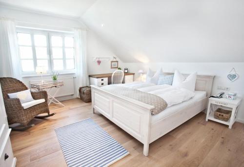 Ein Bett oder Betten in einem Zimmer der Unterkunft Belle Maison - Das kleine Hotel
