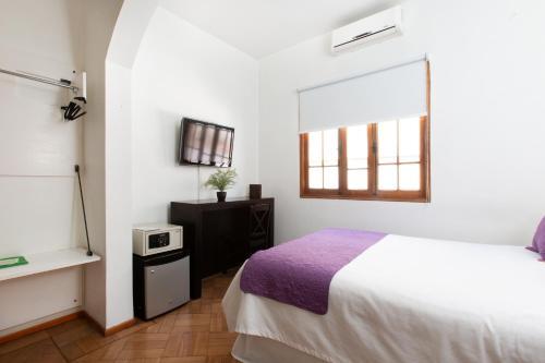 Cama ou camas em um quarto em CasaDeTodos B&B Boutique