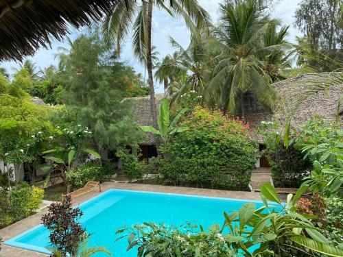Bazén v ubytování Miramont Retreat Zanzibar nebo v jeho okolí