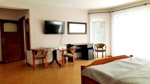 Telewizja i/lub zestaw kina domowego w obiekcie Hotel Diadem