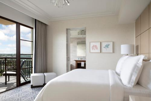 A bed or beds in a room at Four Seasons Resort Orlando at Walt Disney World Resort