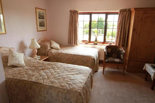 A bed or beds in a room at Pointers Guest House