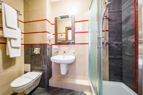 Ванна кімната в Taurus Hotel & SPA