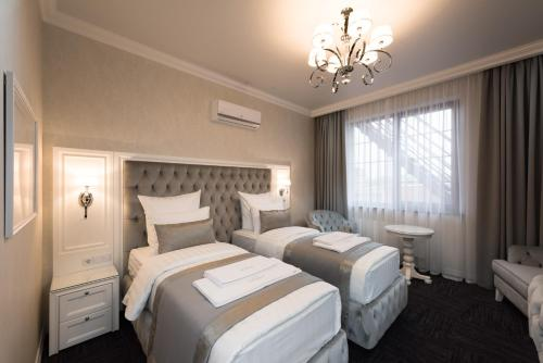 A bed or beds in a room at Boutique-hotel Stolica