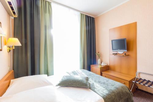 Кровать или кровати в номере Гостиница Экватор