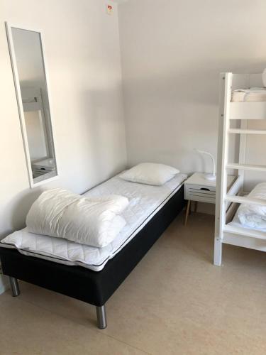 Säng eller sängar i ett rum på Gotlands Idrottscenter