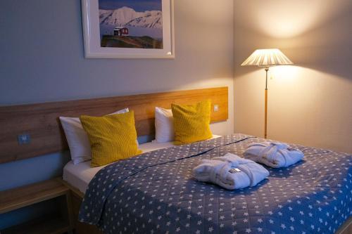 Кровать или кровати в номере Стандарт - Отель