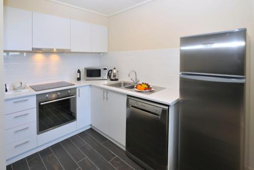 A kitchen or kitchenette at Grand Hotel Melbourne