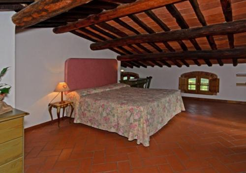 A bed or beds in a room at I Sette Borghi