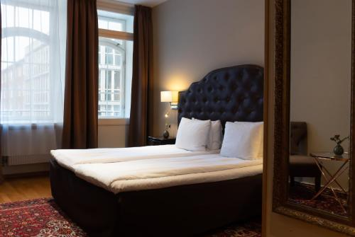 A bed or beds in a room at Best Western Hotel Karlaplan