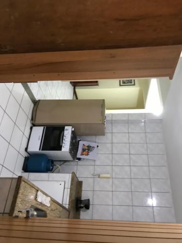A kitchen or kitchenette at Apartamento 1 por andar