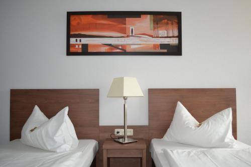 Ein Bett oder Betten in einem Zimmer der Unterkunft Quality Hotel Erlangen
