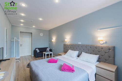 Кровать или кровати в номере Star Home