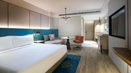 A bed or beds in a room at Amari Watergate Bangkok - SHA Certified