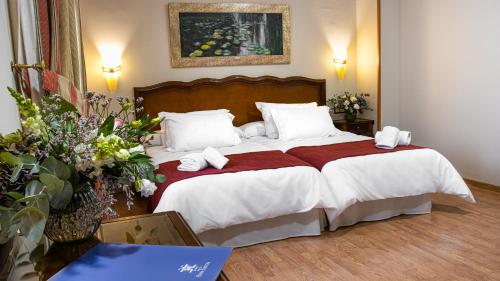A bed or beds in a room at Reina Cristina