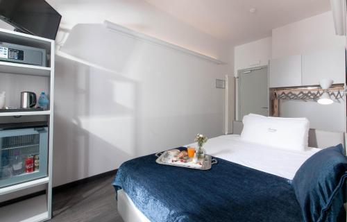A bed or beds in a room at Hotel Touring