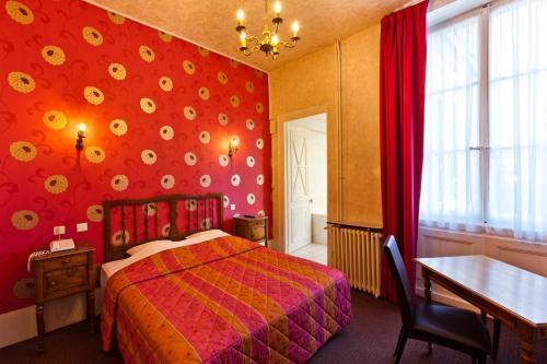 Cama o camas de una habitación en Hotel Du Nord
