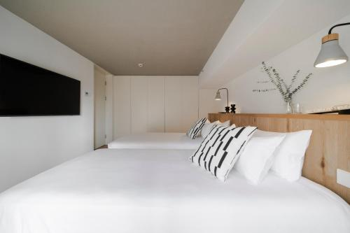 A bed or beds in a room at The Bridge House by Cohost