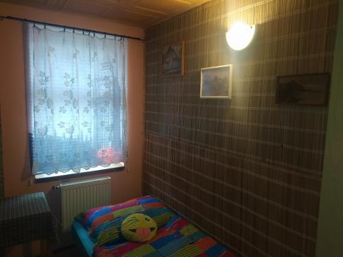 Postel nebo postele na pokoji v ubytování Dřevěnka
