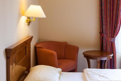 Ein Sitzbereich in der Unterkunft Hotel Schlossgarten