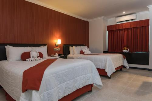 Een bed of bedden in een kamer bij Hotel Ocean View