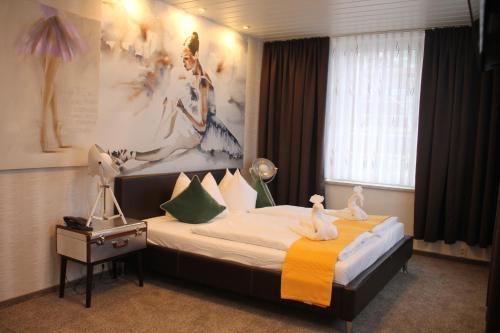 Ein Bett oder Betten in einem Zimmer der Unterkunft Boulevardhotel Sängerstadt