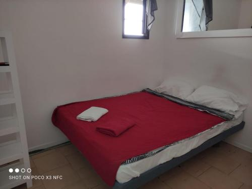 A bed or beds in a room at Hostel in Eilat