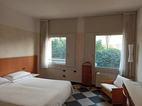 A bed or beds in a room at Residence Hotel Siloe