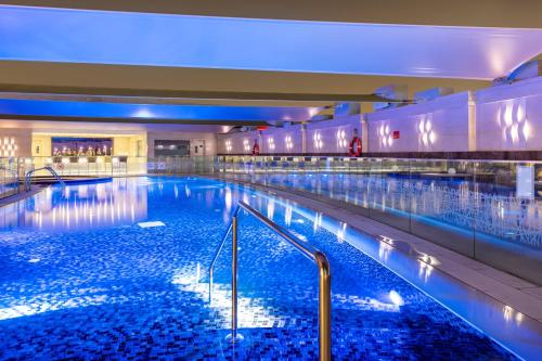 The swimming pool at or near Crowne Plaza Doha - The Business Park, an IHG hotel