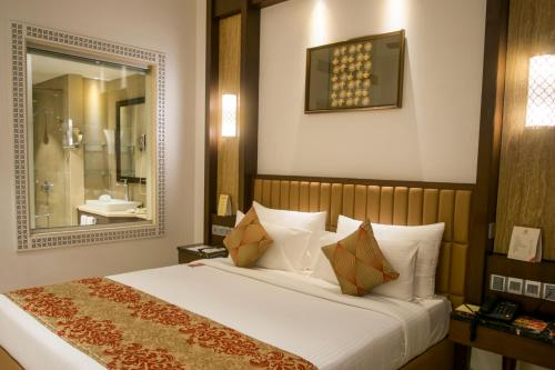 A bed or beds in a room at The Corinthians Resort & Club