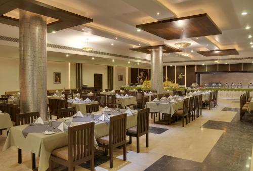 A restaurant or other place to eat at Inder Residency Udaipur