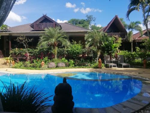 The swimming pool at or near Homestay Chiangrai