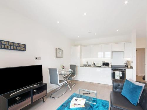 A television and/or entertainment centre at Lily Rose Apartment
