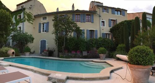 The swimming pool at or near Hostellerie Le Beffroi, The Originals Relais (Relais du Silence)